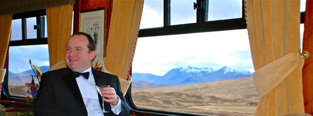 Enjoying a drink in the Royal Scotsman stylish, but very comfortable, bar car. IRT Photo by Eleanor Hardy