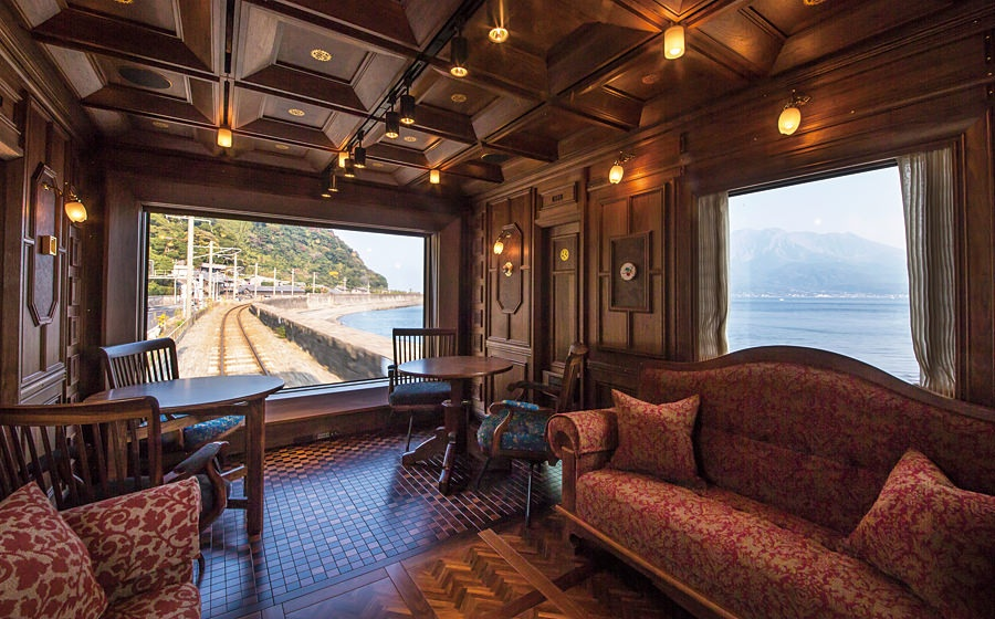 Japan's Kyushu Seven Stars luxury train includes 12 suites, 2 deluxe suites, a diner and (above) lounge, with bar. By all accounts, the train is a work of art, boasting exquisite woods and fabrics. Kyushu Railway Photo