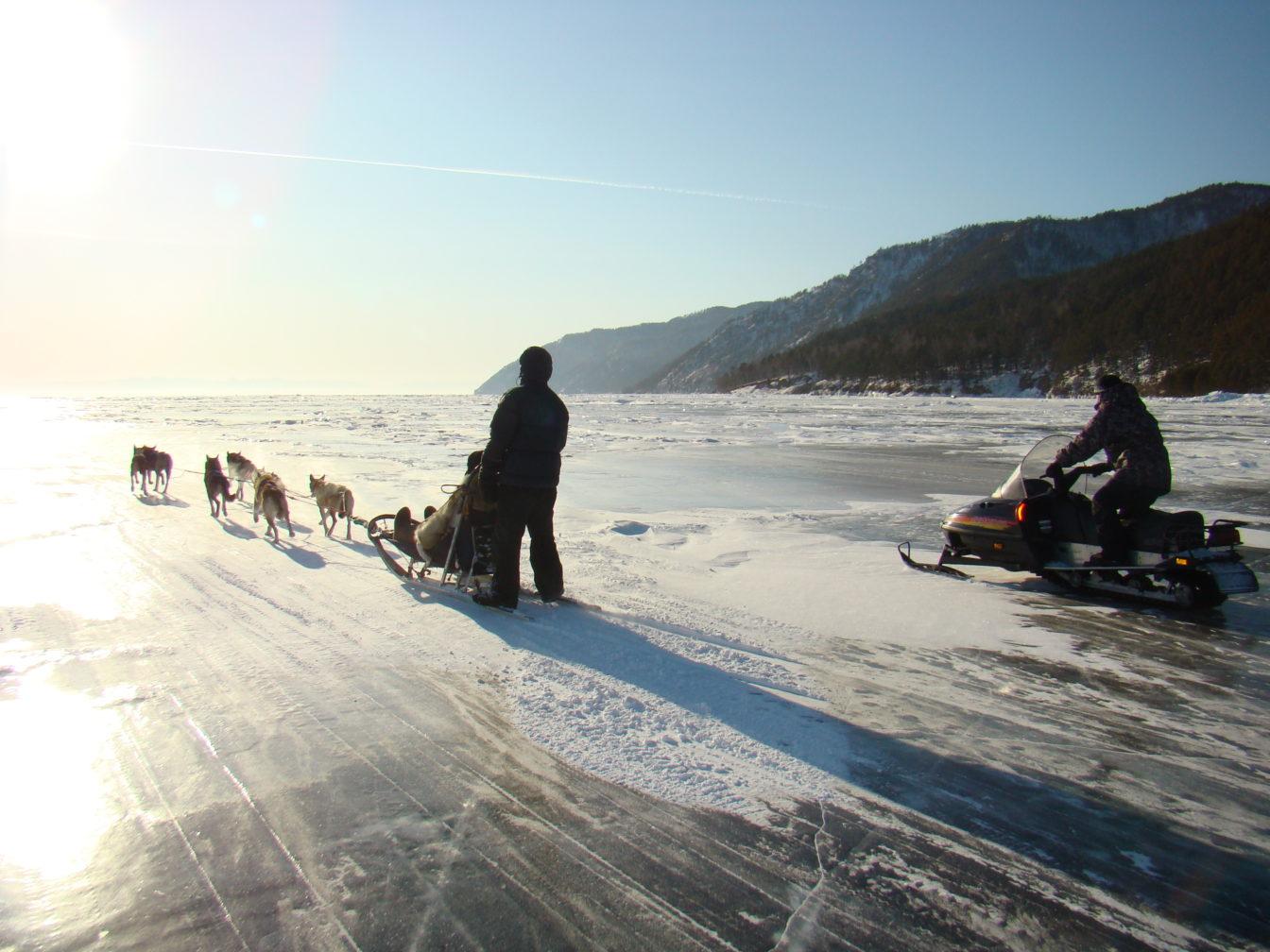 Dog sledding over ice at Lake Baikal.