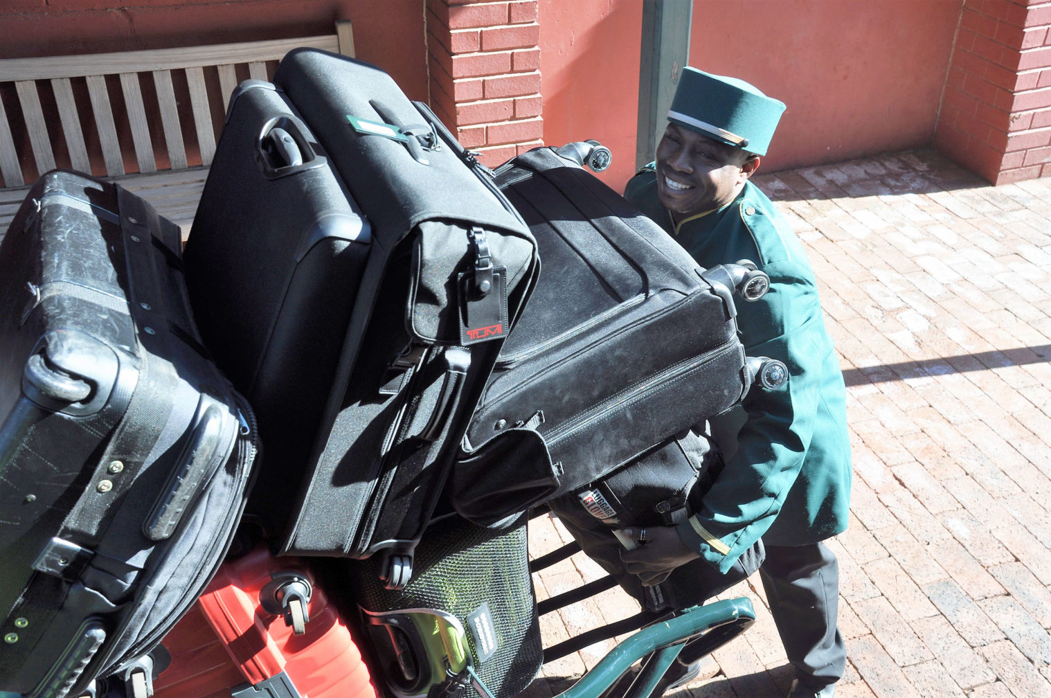 Luggage is whisked away by friendly Rovos Rail porters the moment you arrive at the station. IRT Photo by Angela Walker.