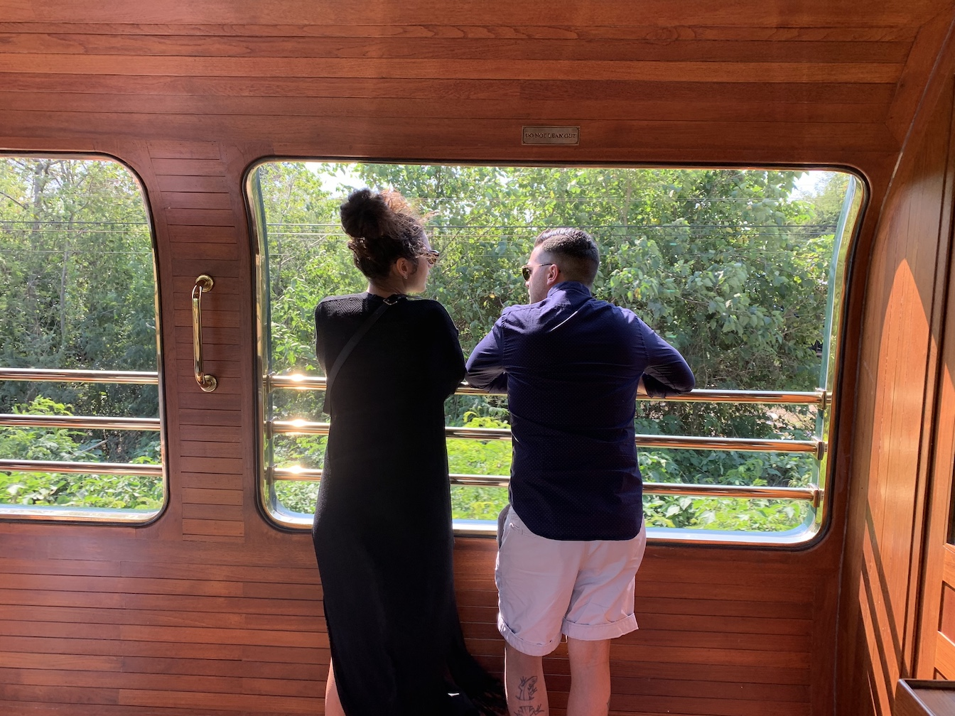 Couple on observation car of Eastern & Oriental Express