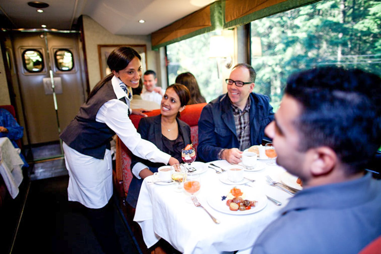 Serving guests food on the Canadian Rockies Getaway Circle journey