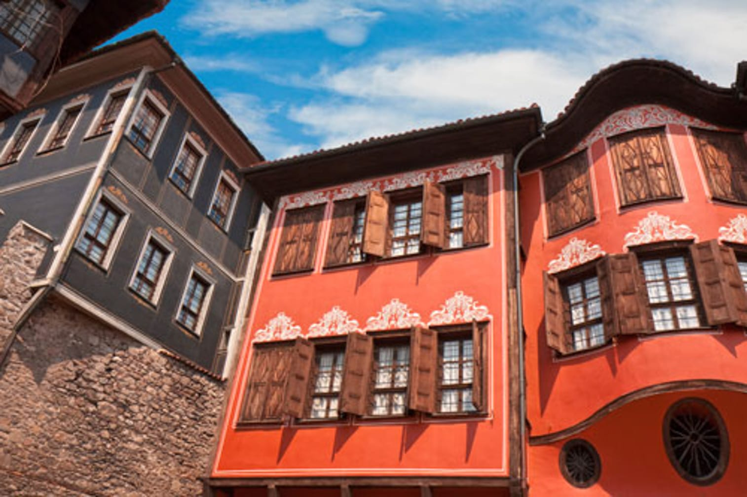 Red buildings on the Castles of Transylvania: Istanbul to Budapest aboard the Danube Express journey