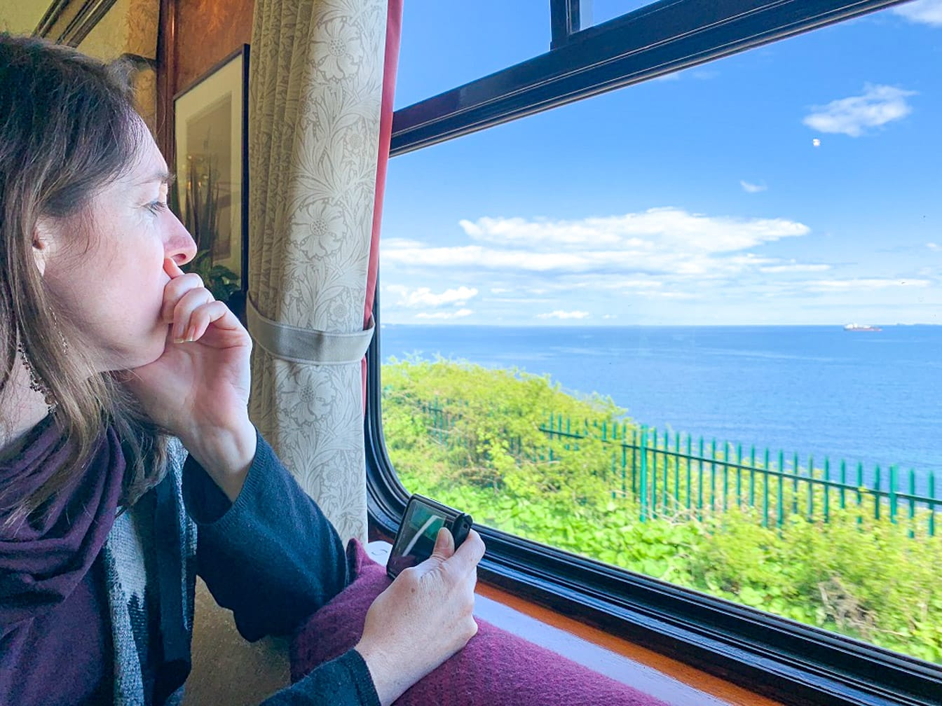 Woman staring out the window on the Grand Tour of Great Britain journey