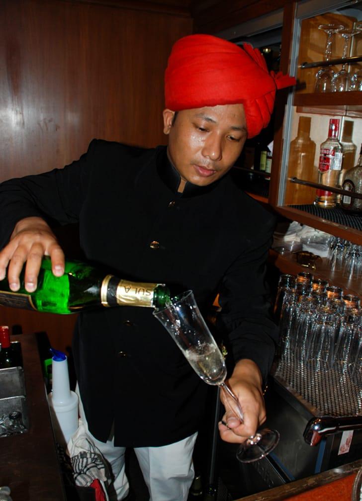 Pouring drinks on the Maharajas' Express Indian Splendor, Delhi-Mumbai journey