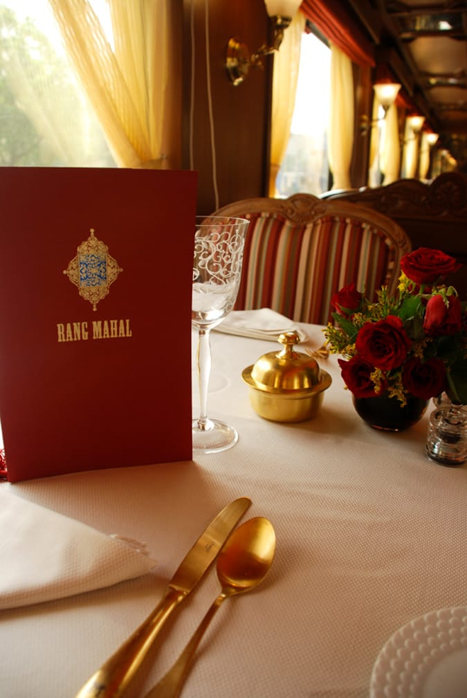 Red menu on a dining table on the Maharajas' Express Indian Panorama, Delhi-Delhi journey
