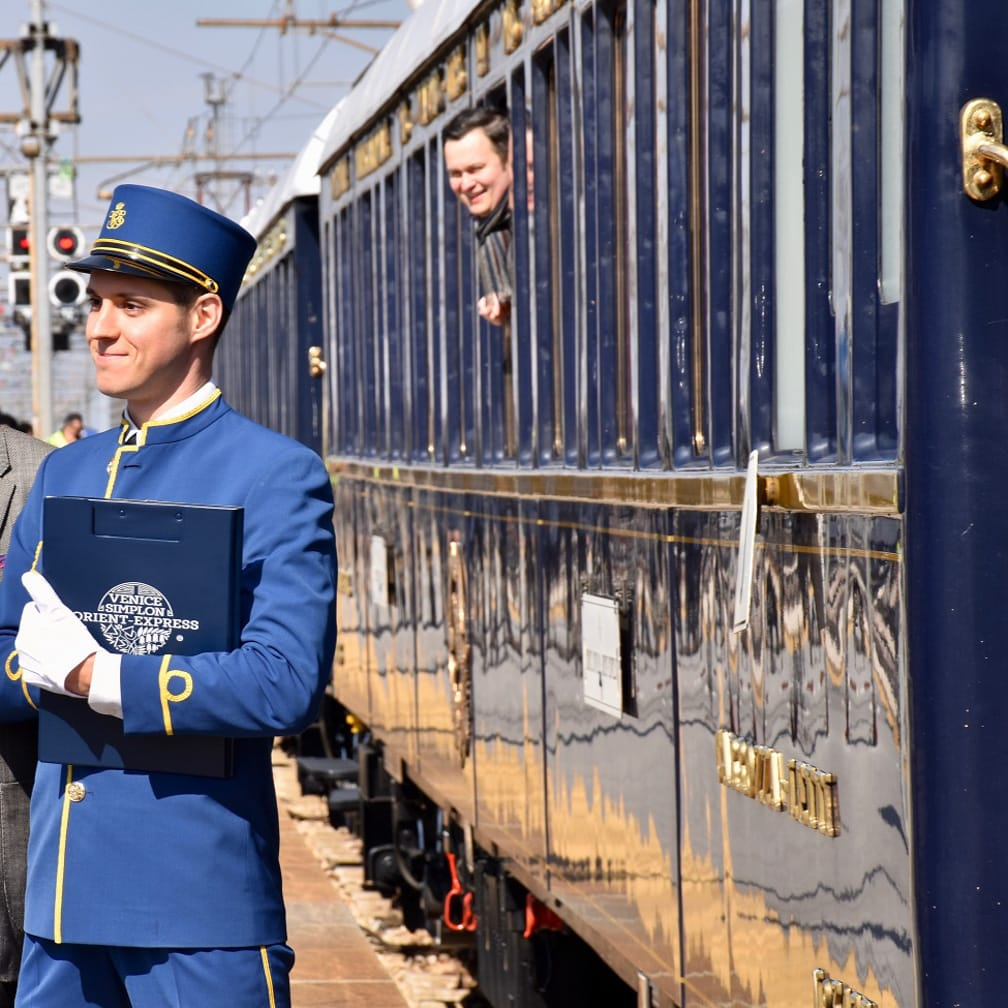 Steward standing by train on the Paris to Istanbul Annual Journey on the Venice Simplon-Orient-Express journey