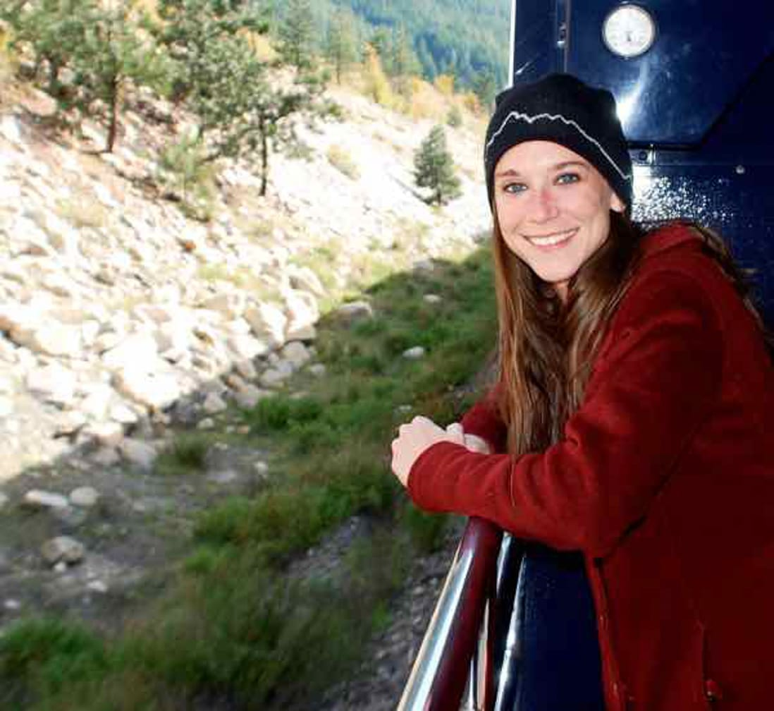 IRT's Rachel Hardy aboard the Rocky Mountaineer on the observation platform