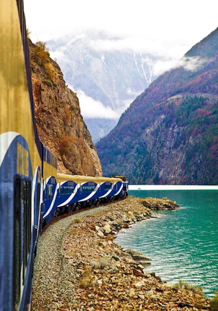 Train on the Rocky Mountaineer: Journey through the Clouds Explorer passing through mountains