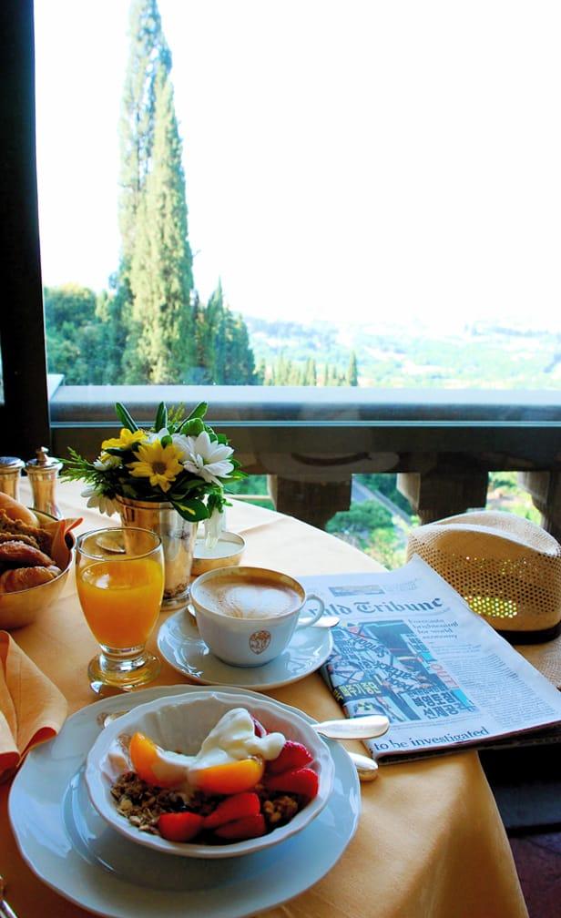 Fresh breakfast with orange juice on the Romantic Italian Holiday journey