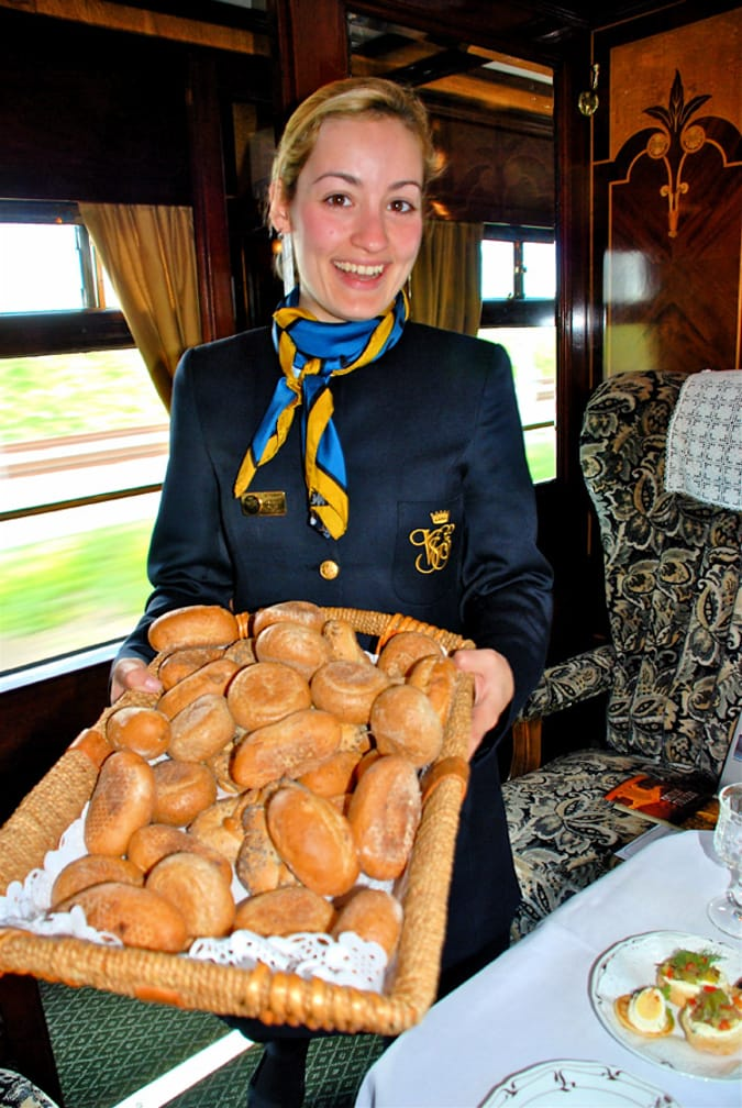 Server offering bread on the Romantic Italian Holiday journey