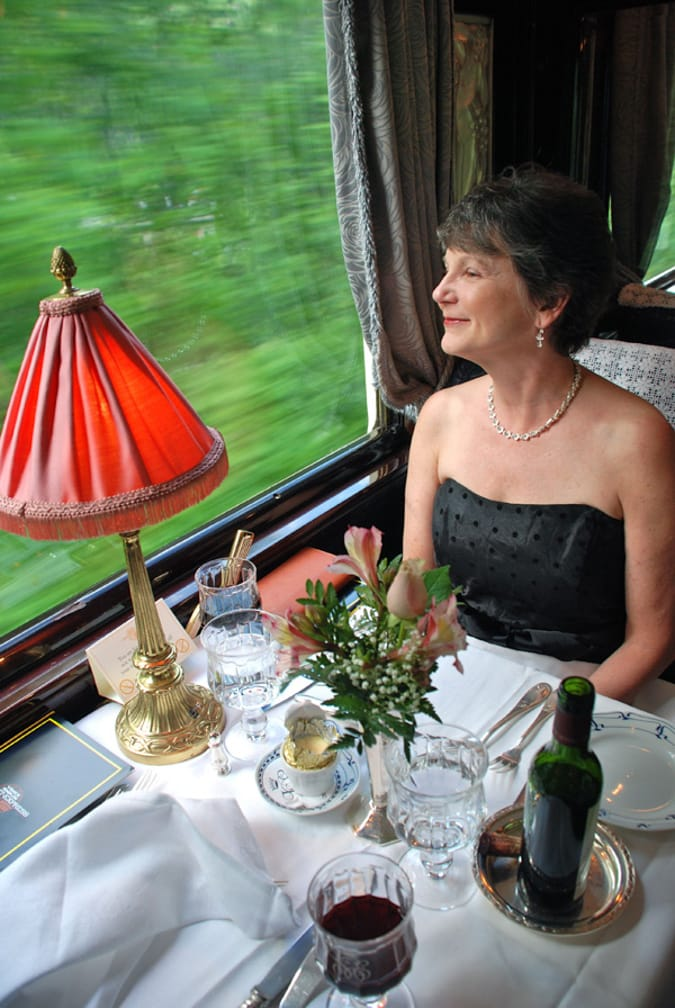 Woman gazing out the window on the Romantic Italian Holiday journey