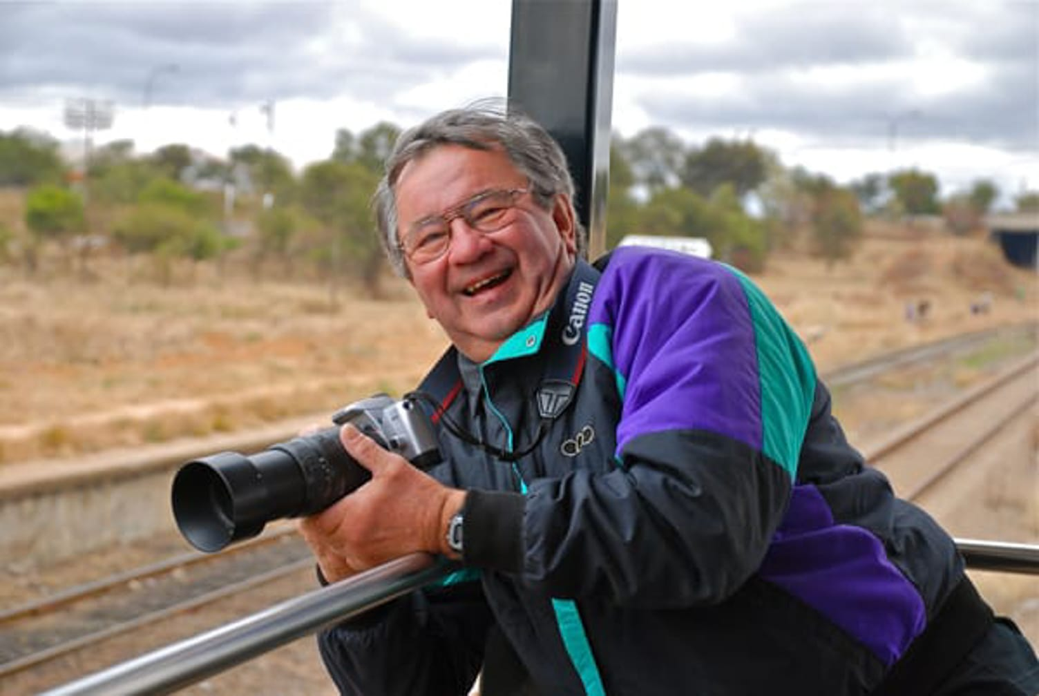 Guest with a camera on the Rovos Rail African Golf Safari journey