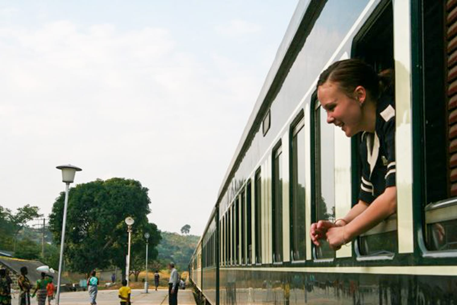 Staff looking out the window on the Rovos Rail's South African Collage From the Mountains to the Sea journey
