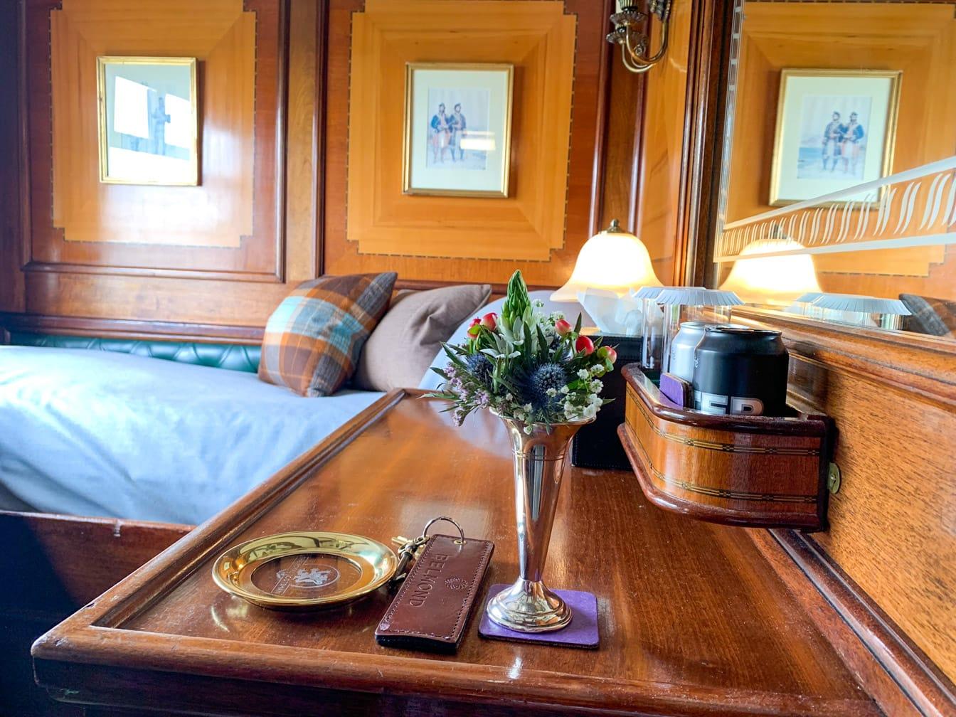 Bedroom with flowers on the Scotland's Classic Splendours journey