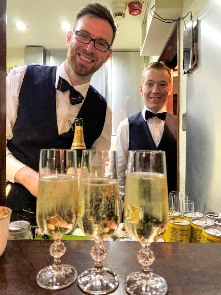 Bartenders serving drinks on the Scotland's Classic Splendours journey