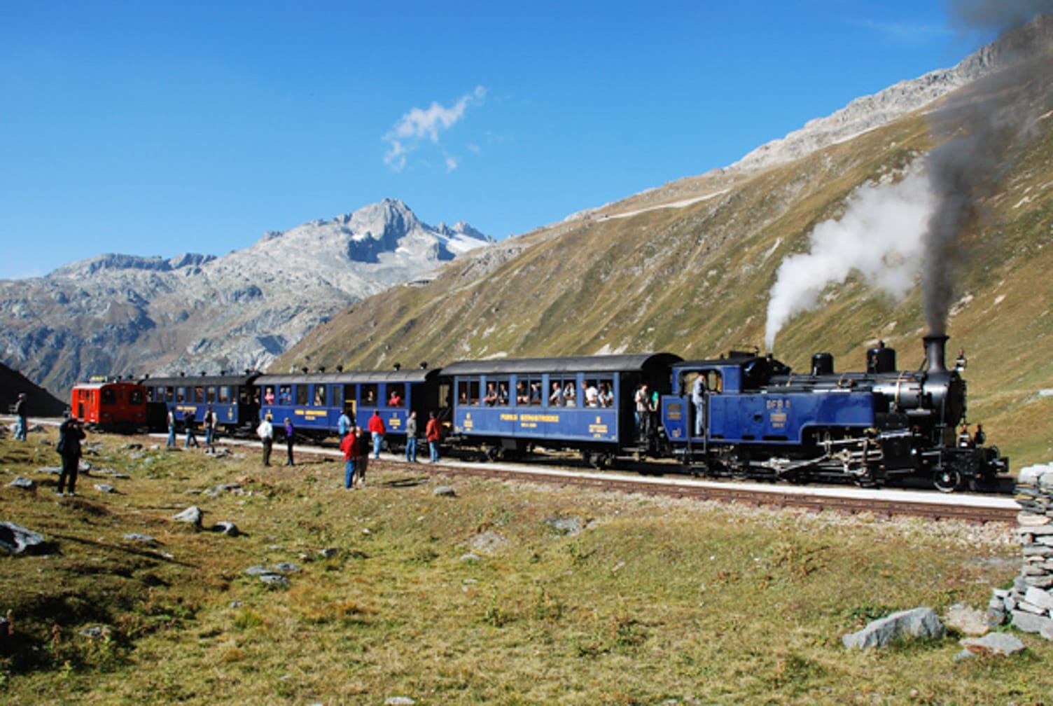 Train going up mountain on the Switzerland's Classic Trains journey