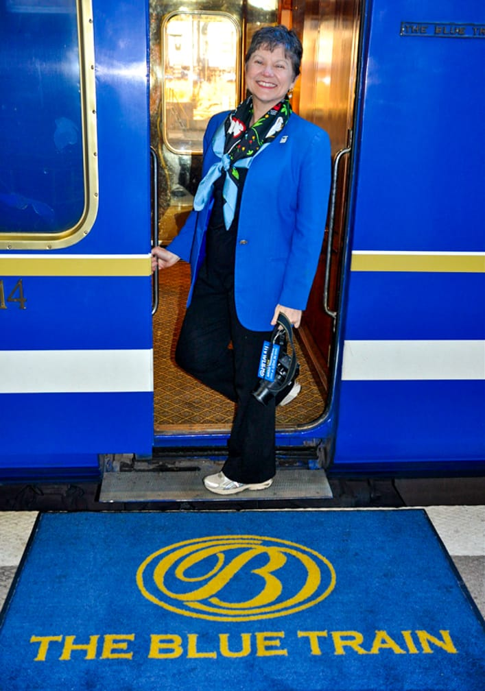 Woman boarding the The Blue Train: South Africa Luxury Train & Safaris train