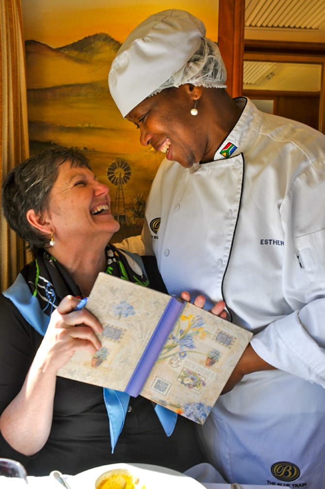 Chef talking to woman on the The Blue Train: South Africa Luxury Train & Safaris journey