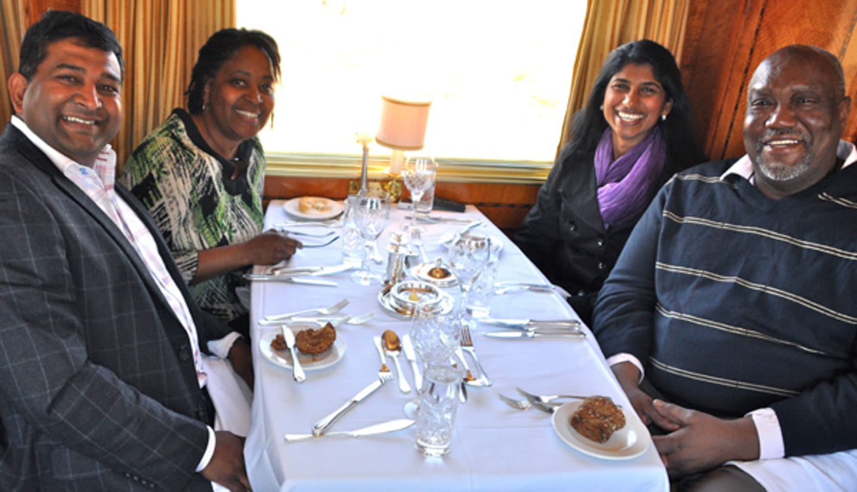 Friends eating on the The Blue Train: South Africa Luxury Train & Safaris journey