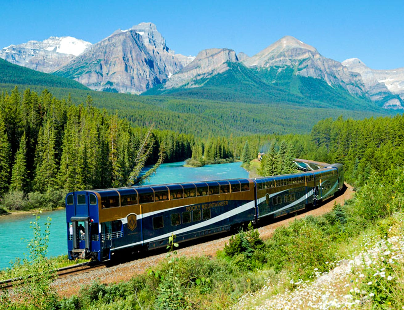 Train going through mountains on the Trans-Canada Rail Adventure: Vancouver-Toronto journey
