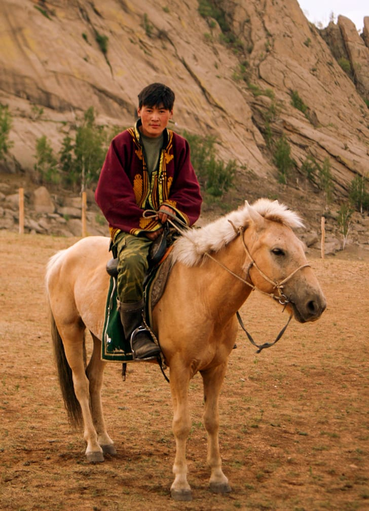 Mangolian man on a horse on the Ulaan Baatar Express: Moscow to Ulaan Baatar journey