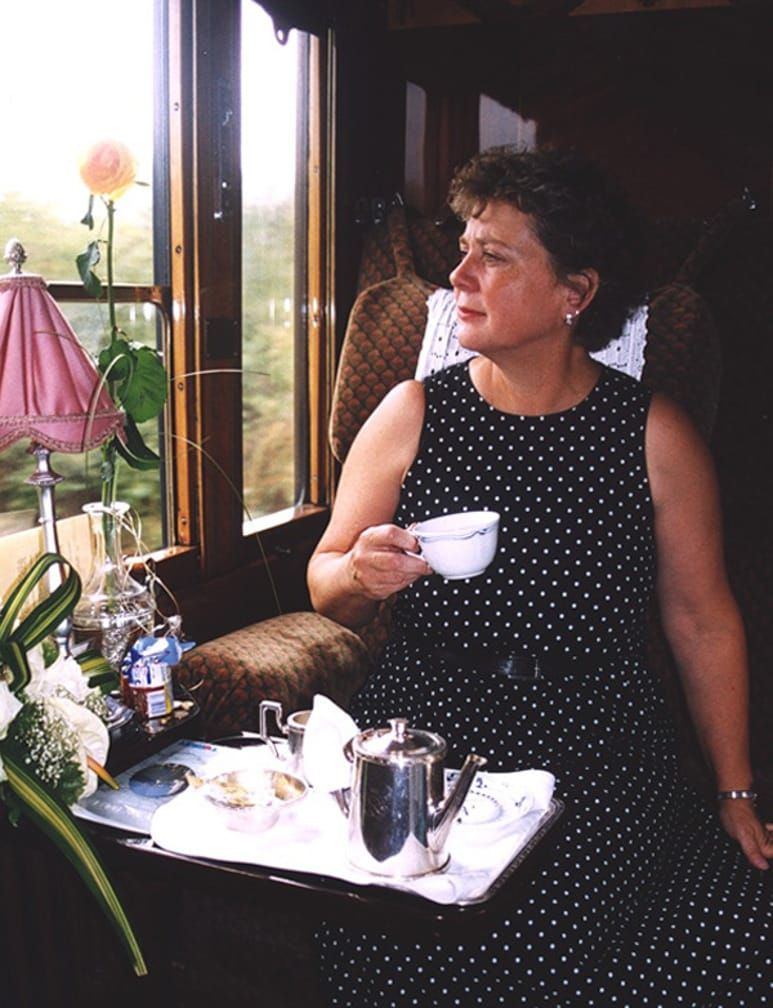 Woman drinking tea on the London-Paris-Venice journey