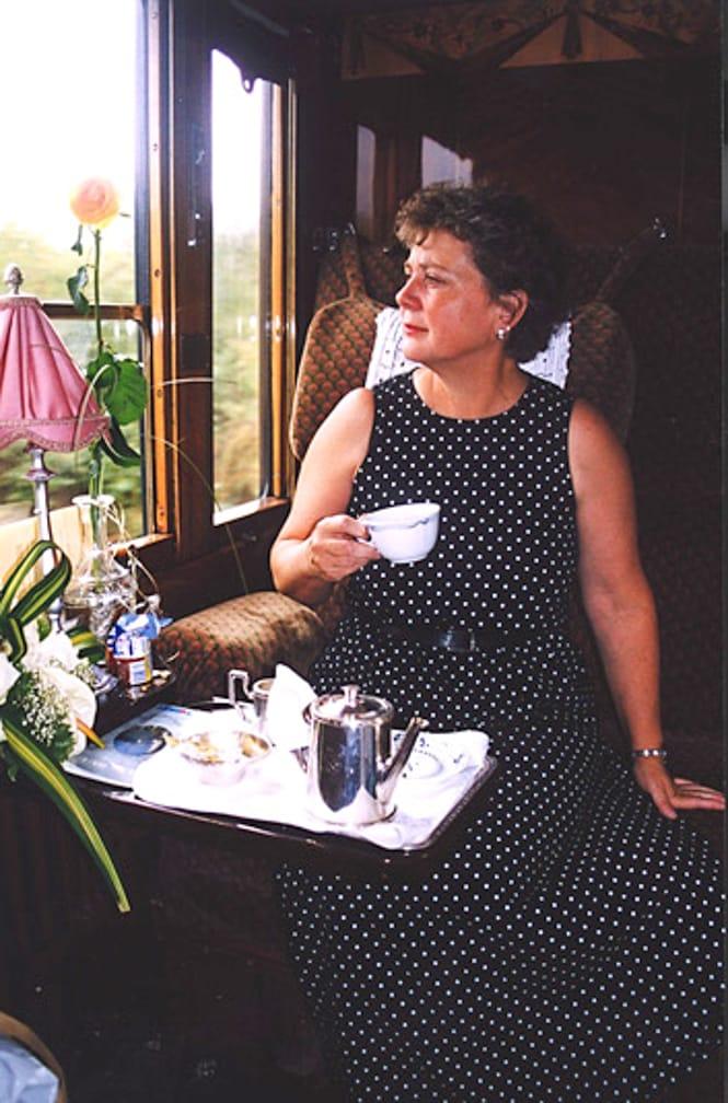 Woman looking out window on the Venice-Prague-Paris-London journey