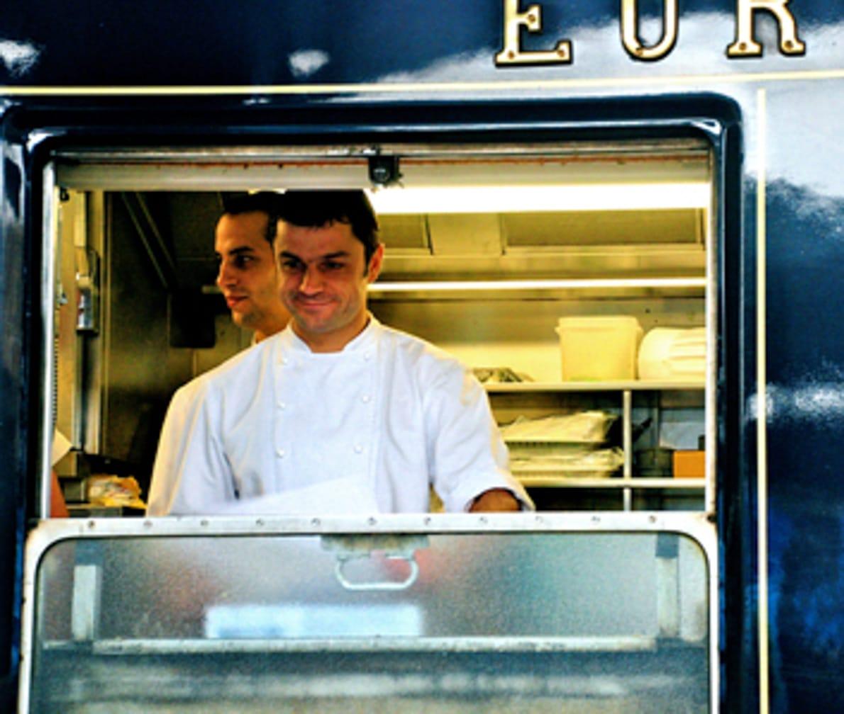 Chef preparing food on the Venice-Vienna-Paris-London journey