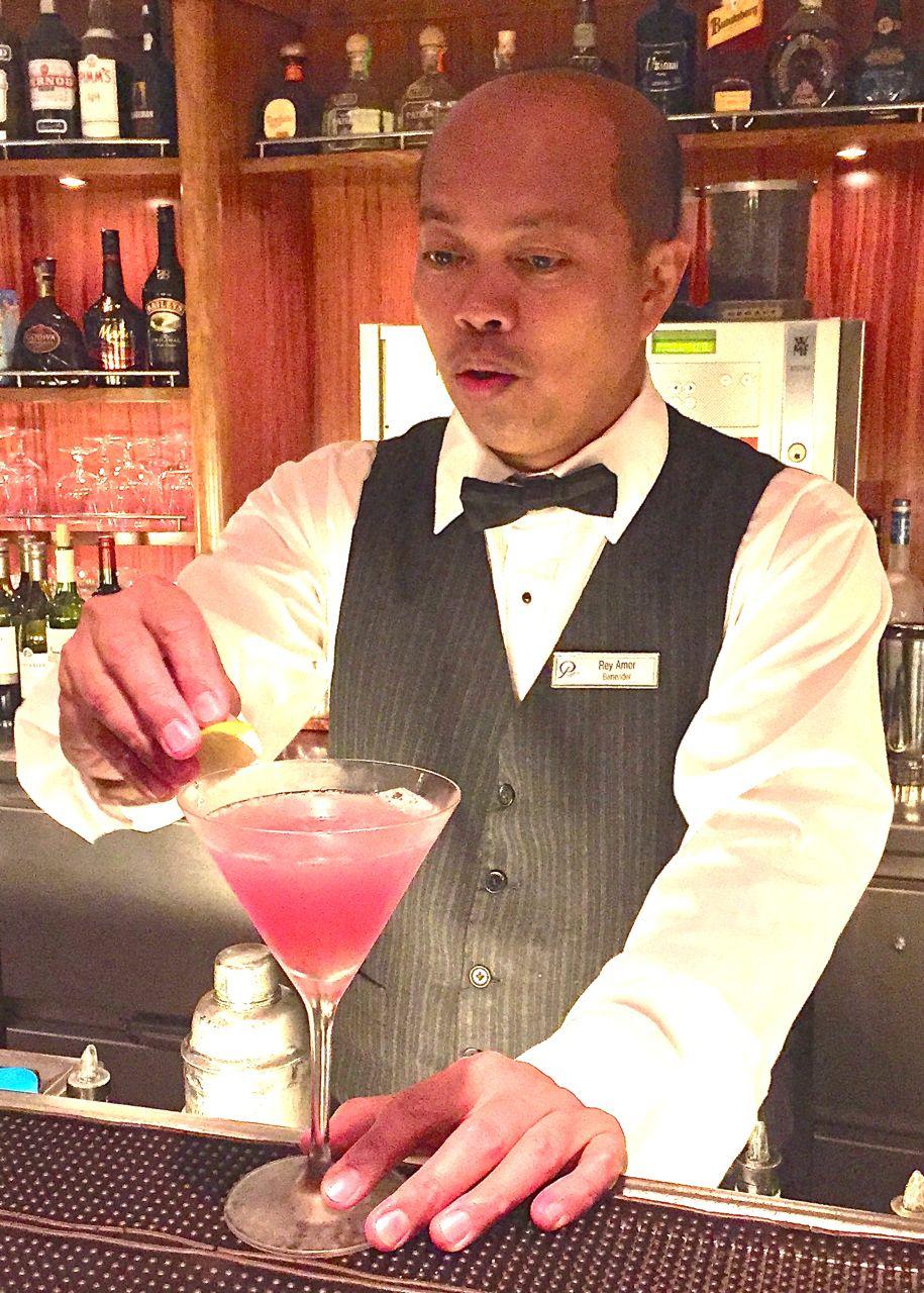 Bartender Rey Amor practices his delicate art. IRT Photo by Angela Walker