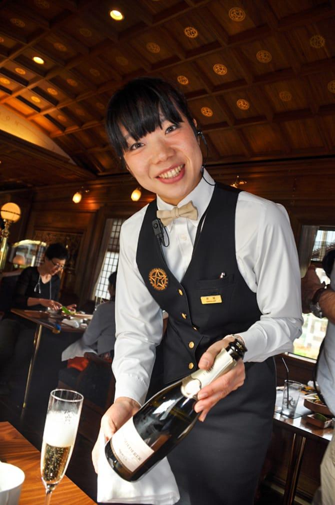 Server on the Seven Stars on the Japan Luxury Rail Tour journey