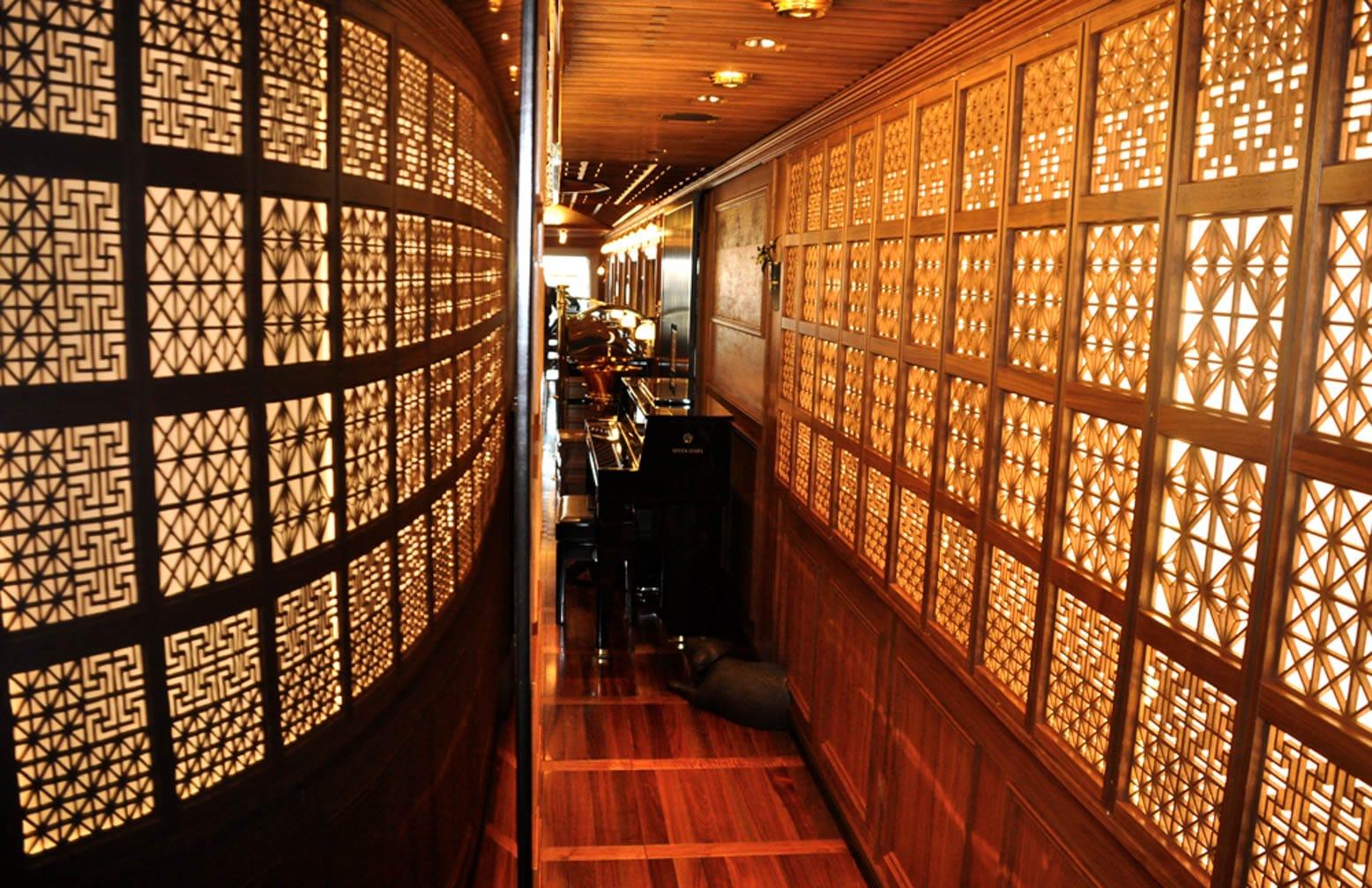 Stunning woodwork panels on the Cruise Train Seven Stars in Kyushu on the Japan Luxury Rail Tour journey