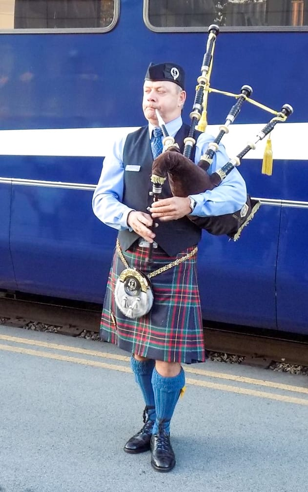 Man playing bagpipes on the Rocky Mountaineer: Ultra-Luxe Canadian Rockies Adventure journey