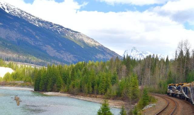 Rocky Mountaineer_River with train REV