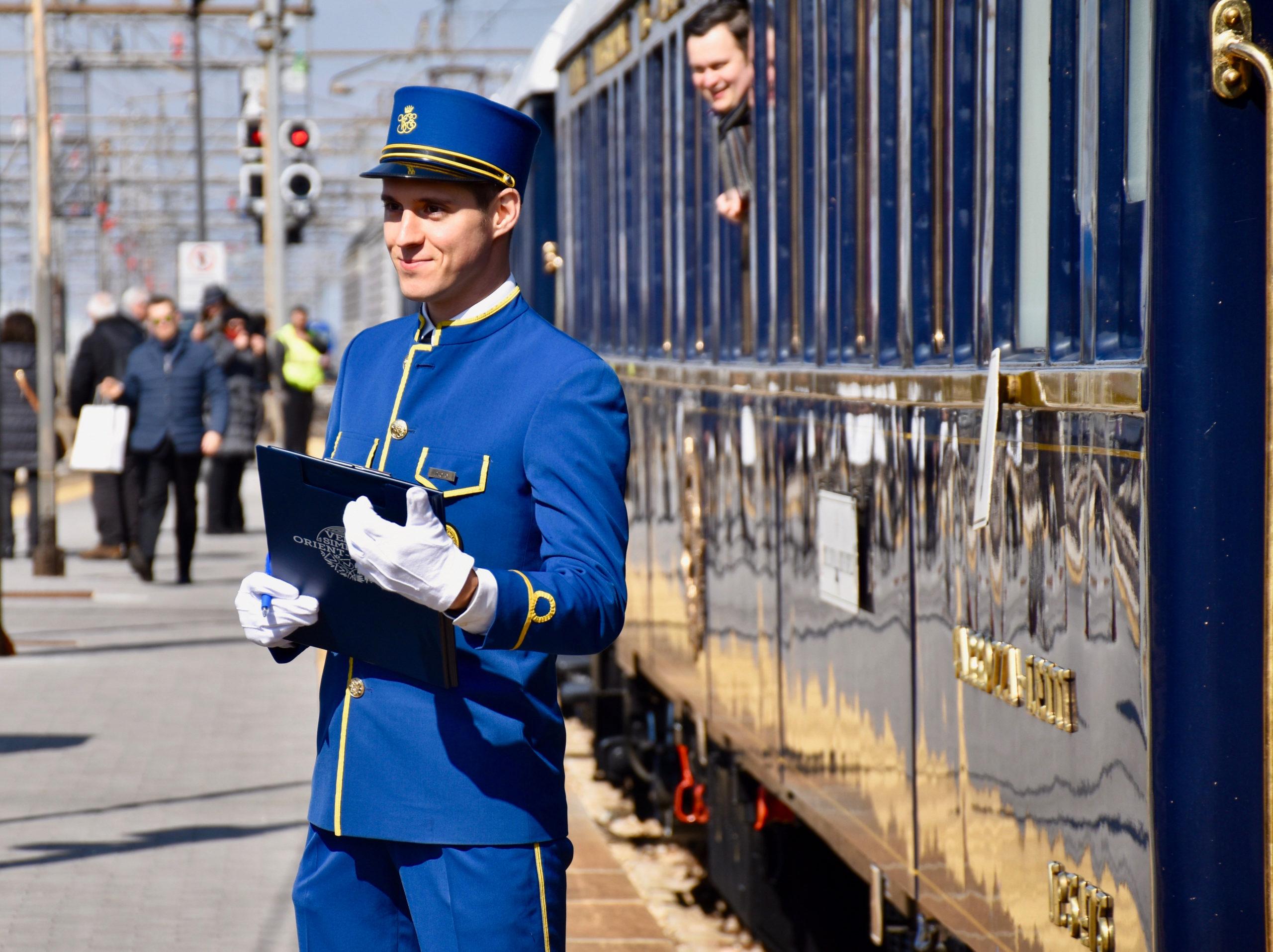 Steward outside train