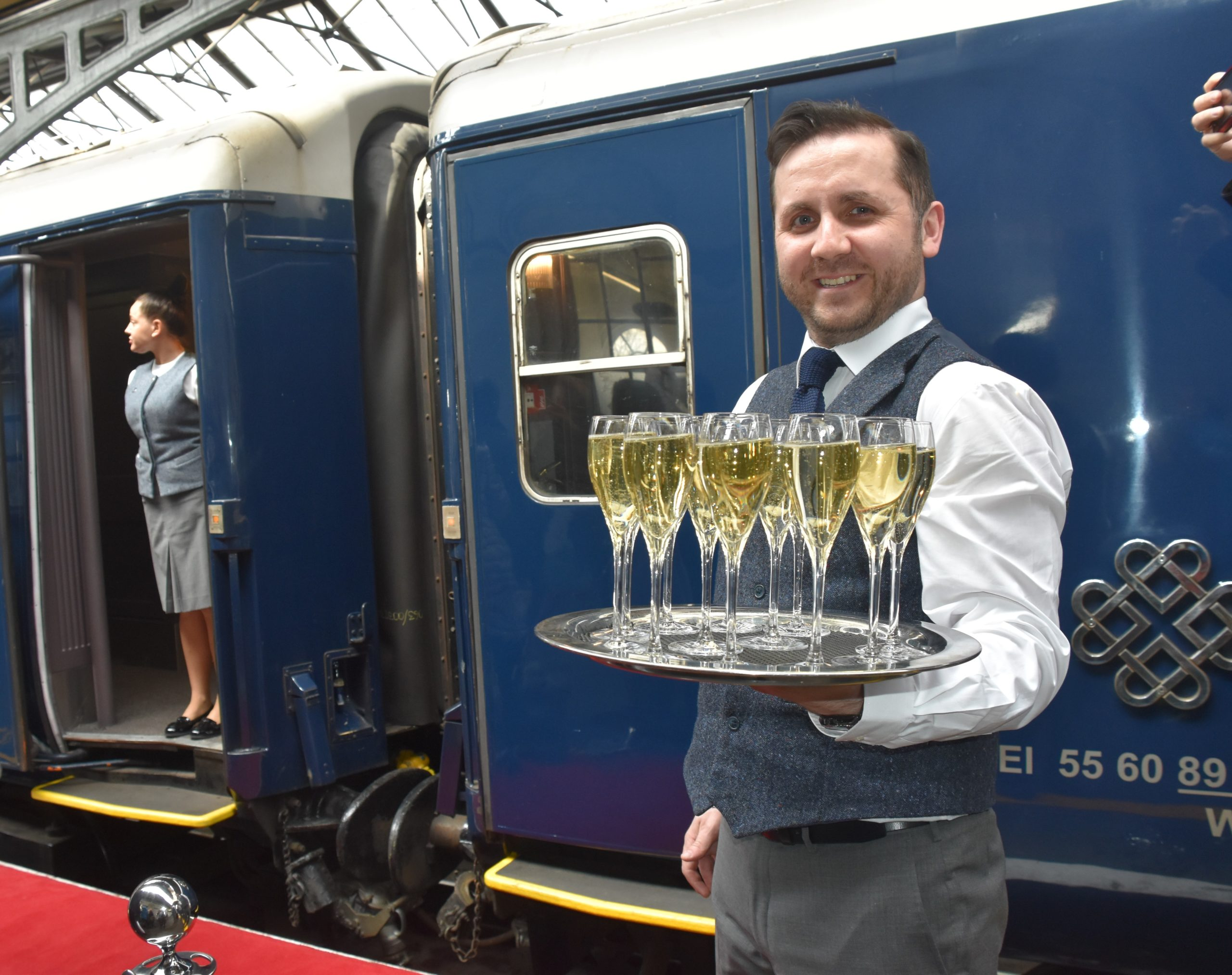 Server with champagne_outside_train.jpg