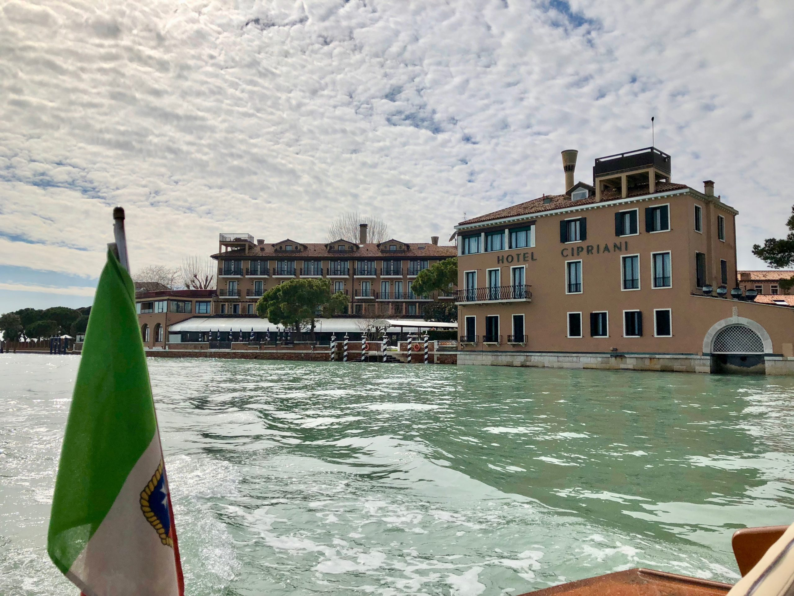 cipriani from lagoon with flag