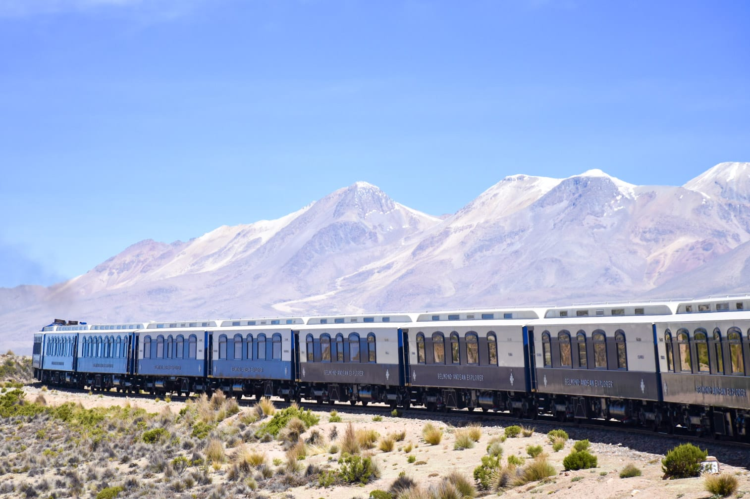 Belmond Andean Explorer train with mountains in the background