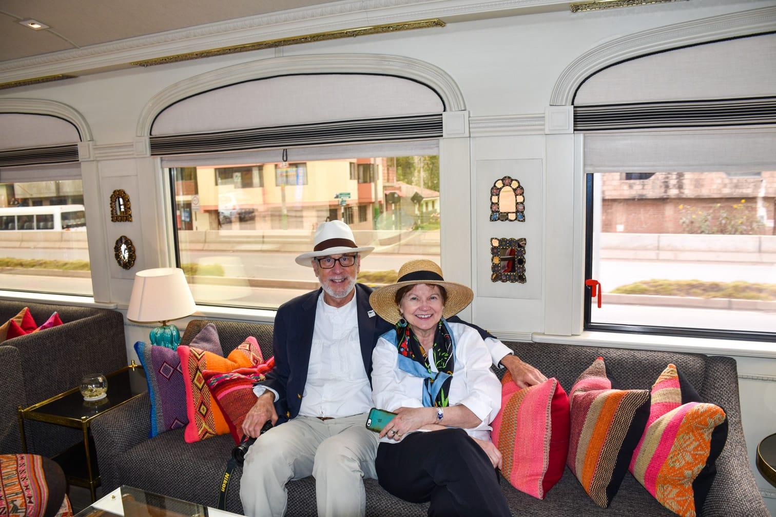 Older couple sitting on the Belmond Andean Explorer train