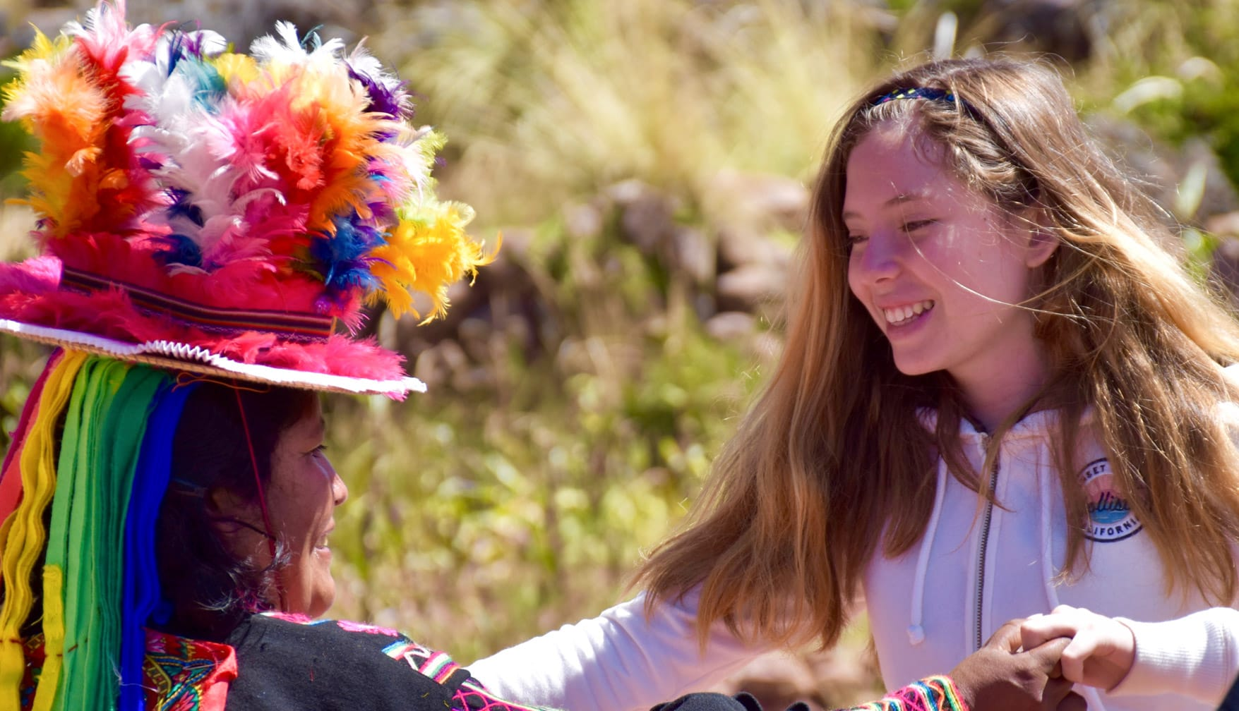 Girl dancing while on the Belmond Andean Explorer train