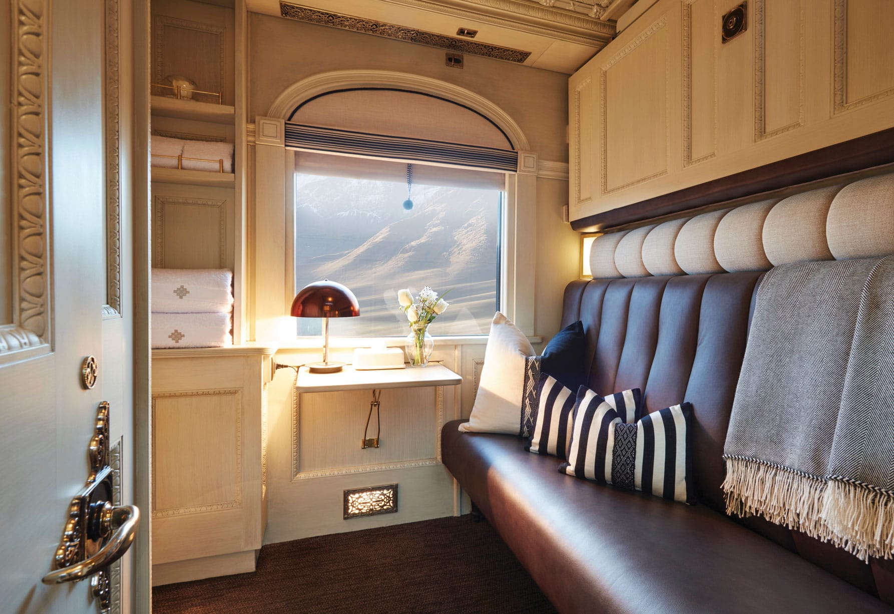 Twin bed and couch on the Belmond Andean Explorer train