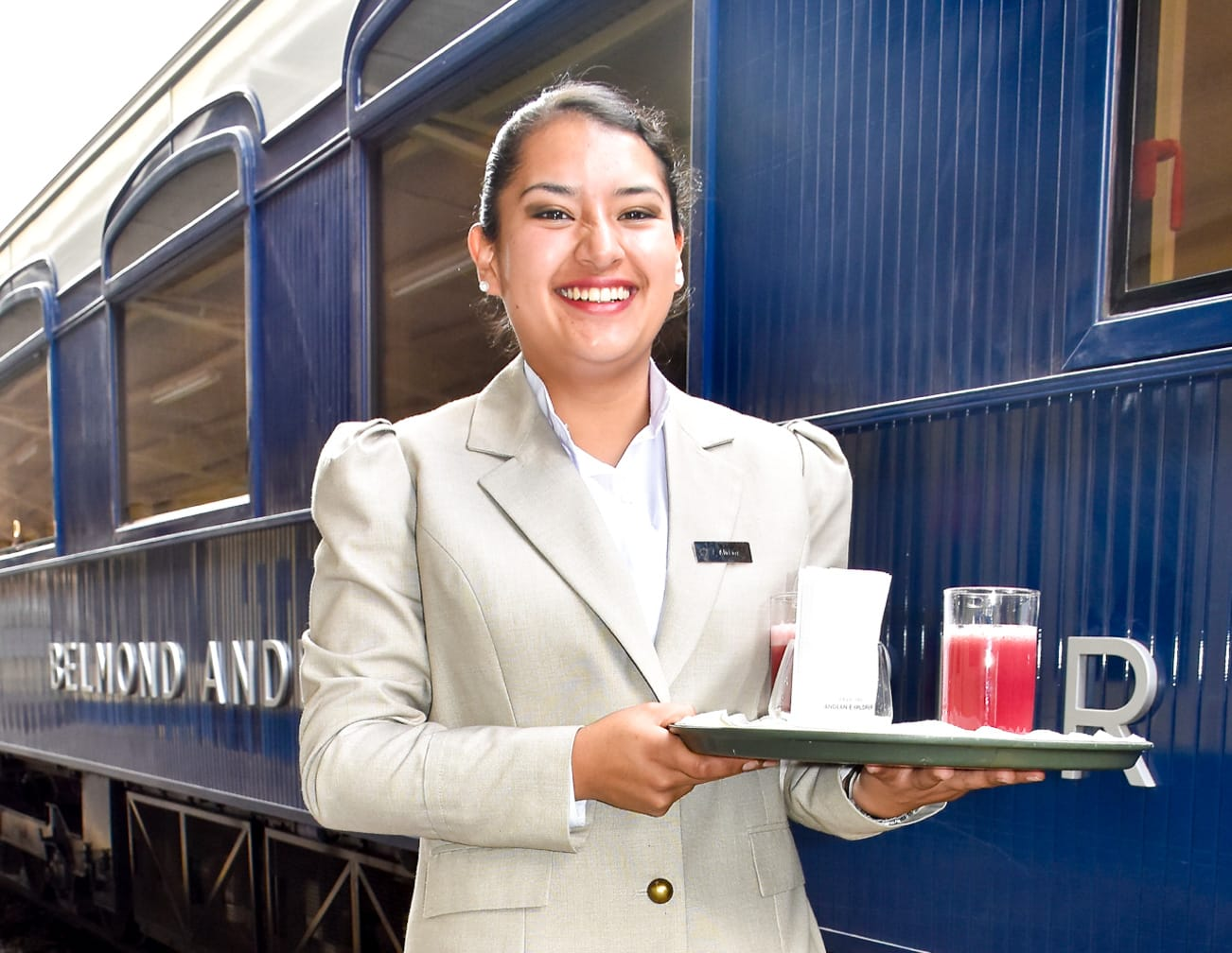 Server with drinks on the Belmond Andean Explorer