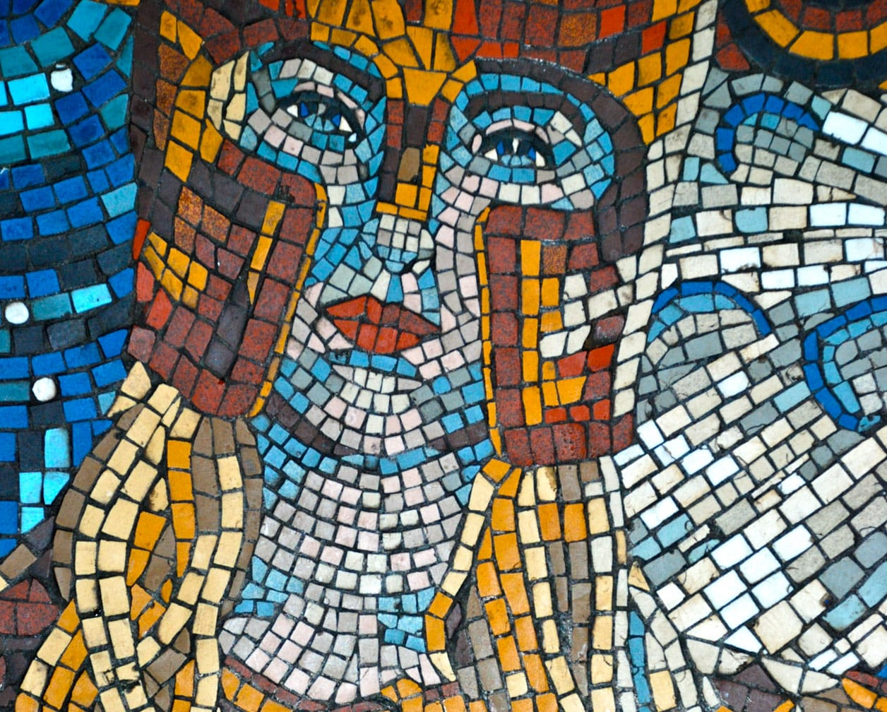 Colorful mosaic of a face on the Belmond British Pullman train
