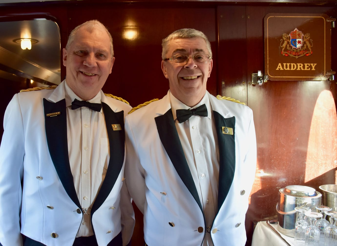 Two staff on the Belmond British Pullman train