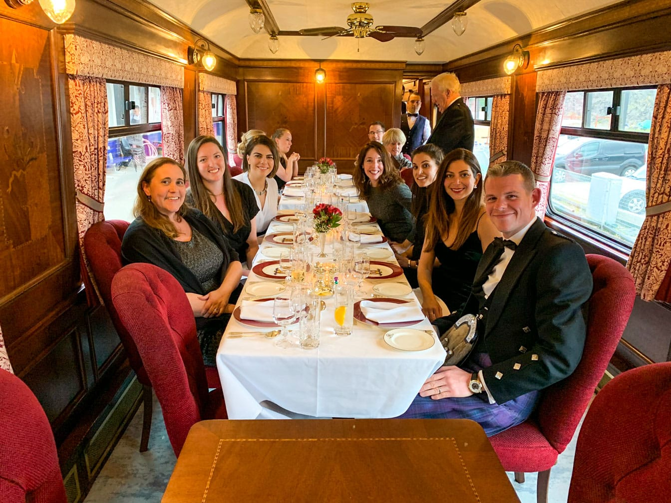 Guests eating dinner on the Belmond Royal Scotsman train