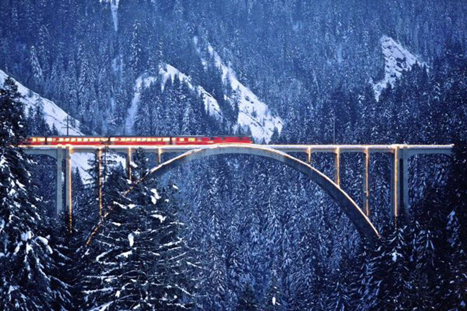 The Bernina Express at dusk. Nothing beats a visit to the snug, warmly lit dining car as stars twinkle in the darkening sky.
