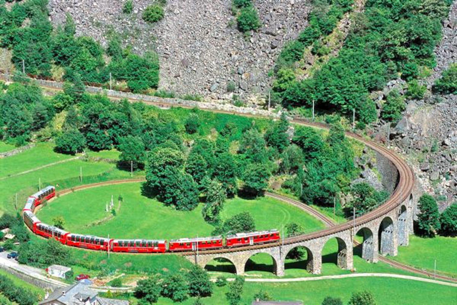 The Bernina Express on the well-known circle viaduct near Brusio. (Photo: Rhaetische Bahn; swiss-image.ch/Peter Donatsch)