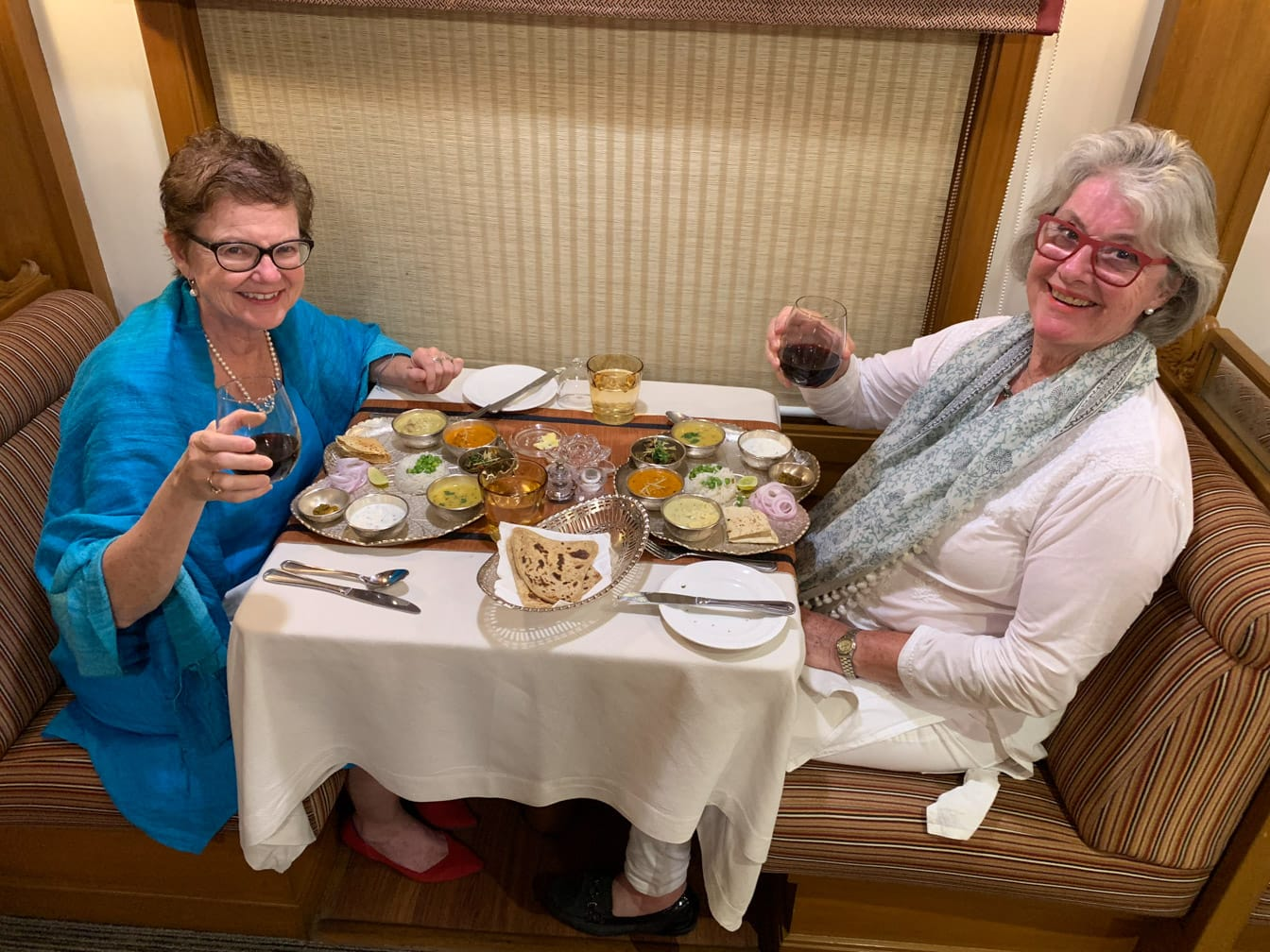 Two women eating an Indian meal on the Deccan Odyssey train