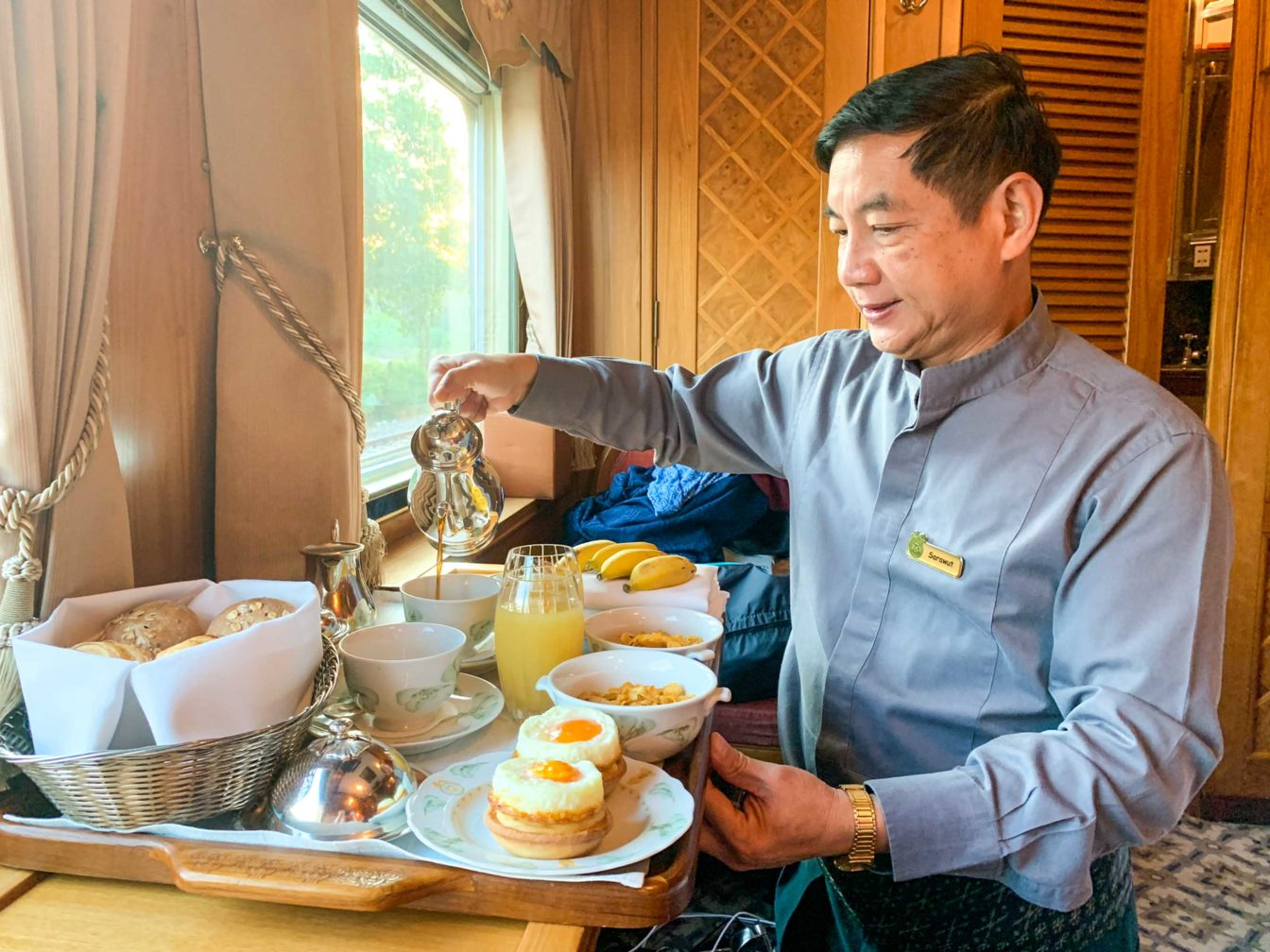 Attendant pouring coffee on the Eastern & Oriental Express