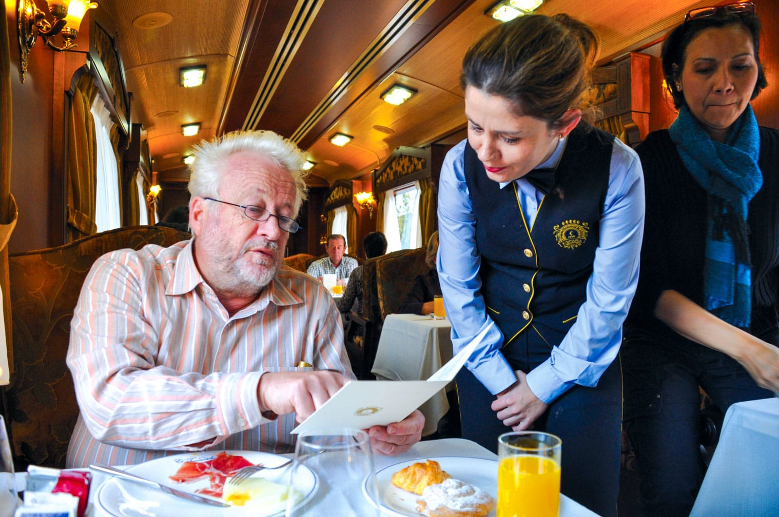 Server taking guests order on the El Transcantábrico Gran Lujo train